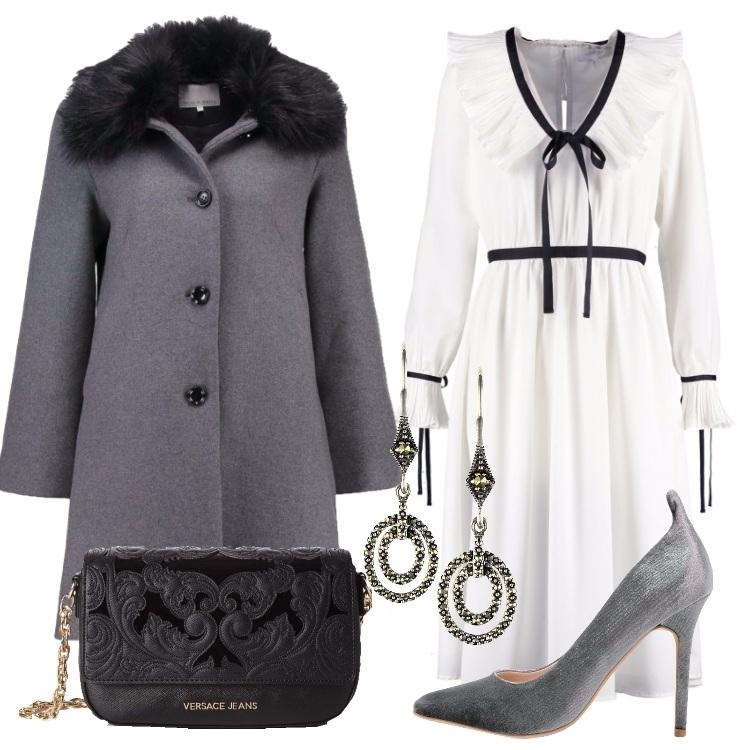 Outfit L'abito bianco nastrini e fiocchi
