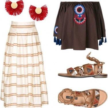 Outfit Etno chic tra frange e perline