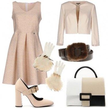 Outfit Bon ton con dettagli in pelliccia