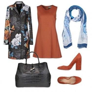Outfit Fantasia su sfondo ardesia e mattone