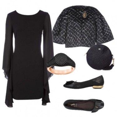 Outfit Nero e oro nei dettagli