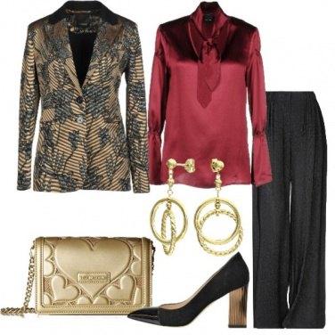 Outfit Giacca oro e pantalone glitterato