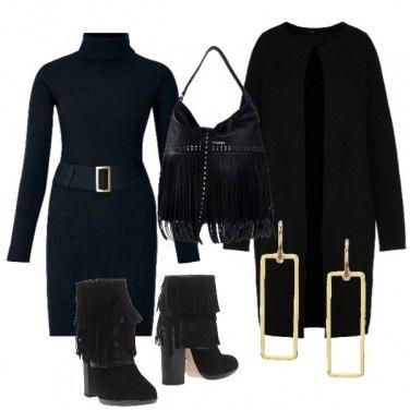 Outfit Total Black e tante frange