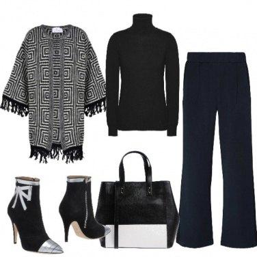 Outfit Fantasia optical e pantaloni a palazzo