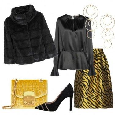 Outfit Eco pelliccia nera gonna animalier