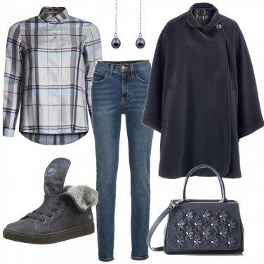 Outfit In ufficio in jeans e sneakers invernali