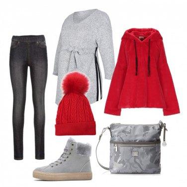 Outfit ideale per andare in montagna. Maglione grigio con