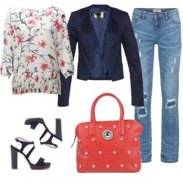 Outfit Jeans, tacchi e borsa griffata