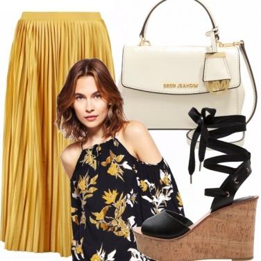 Outfit Gonna plissè: un must dell\'estate