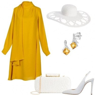Outfit In giallo come Amal Clooney