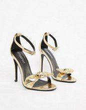 Sandali dorati con tacco e fiocco
