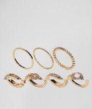 Set da 7 anelli in filigrana e con quarzo rosa sintetico