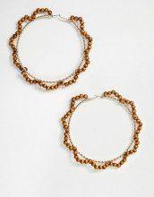 Orecchini a cerchio oversize attorcigliati oro con perline in legno