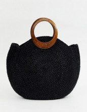 Maxi borsa rotonda nera di paglia con manici in legno