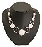 Bedazzled  56196 - Collana con conchiglie bianche e nere a forma di ruota filigranata, in confezione regalo