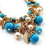 Orecchini a goccia con foglie dorate e perline turchesi in resina e finte perle, lunghezza: 8,5cm