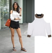 Blusa con cut-out e paillettes
