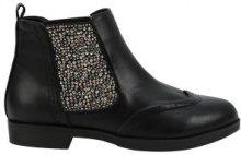 Chelsea boots brogue con borchie