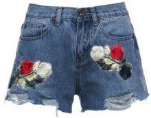 Jeans shorts con toppe a fiori