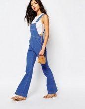 River Island - Salopette di jeans a zampa stile anni '70