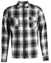 TYGA oversize con giacca camicia a quadri in bianco e nero con cerniera