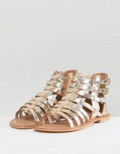ASOS - FOZ - Sandali piatti stile gladiatore in pelle - Oro