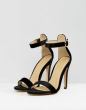 Truffle Collection - Sandali con cinturino sottile e fibbia rotonda - Nero