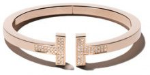 Tiffany & Co - Bracciale rigido medio 'Tiffany T' in oro giallo 18kt - women - 18kt Gold - S, M - METALLIC