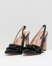 Scarpe con tacco nere con volant e perle