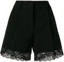 Moschino - lace ribbed shorts - women - Polyester/Polyurethane/Acetate/Polyamide - 38, 40, 42 - Nero