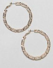 Orecchini a cerchio dorati con design ritorto stile vintage