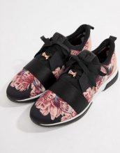 Sneakers sportive nere a fiori