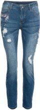 Jeans con pietruzze e zone sdrucite