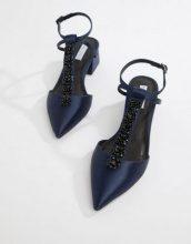 Scarpe a punta con tacco e listini con perline