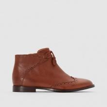 Boots in pelle dettaglio pompons